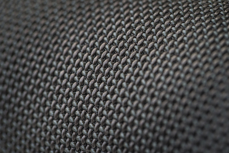 corduroy: Audio speakers black wicker cover - macro shot for background