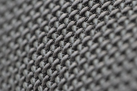 corduroy background: Audio speakers black wicker cover - macro shot for background