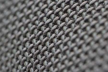 Audio speakers black wicker cover - macro shot for background