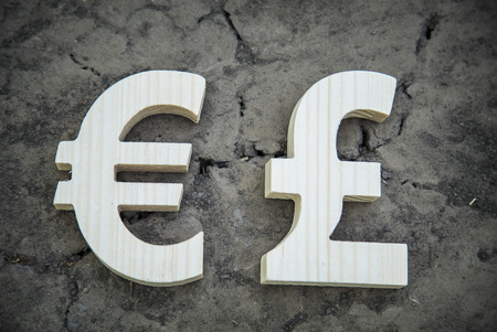 dry land: Exchange currency euro and pound on a dry land. Wooden sign. Stock Photo