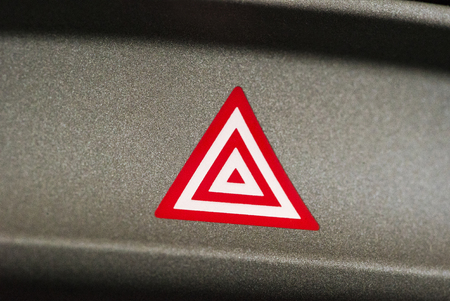 flashers: Emergency attention light button in red triangle Stock Photo