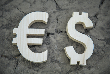 dry land: Exchange currency euro and dollar on a dry land. Wooden sign.