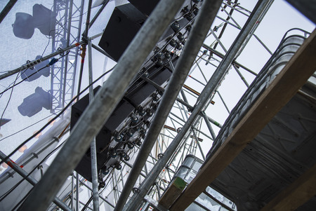 providing: Extensive scaffolding providing platforms for stage structure support