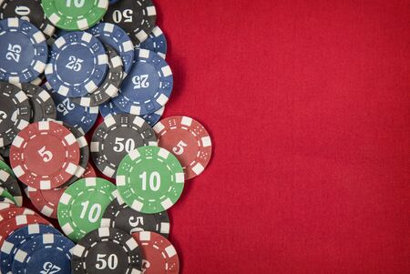 gambling counter: Gambling chips frame on red card table background