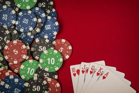 gambling counter: Gambling chips frame and flush royal on red card table background