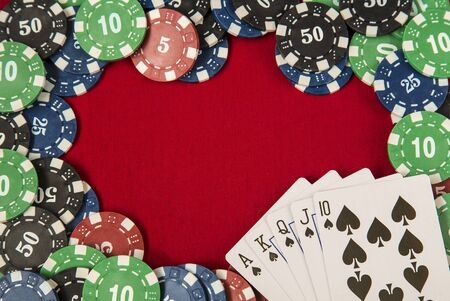 gambling counter: Gambling chips frame around the red card table background and flush royal Stock Photo