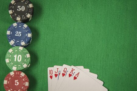 gambling counter: Gambling chips frame and flush royal on green card table background Stock Photo