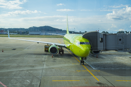 telescopic: Sochi, Russia - September 08, 2016, Aircraft Airlines S7 Airlines in the transition of the telescopic ladder at the airport Sochi Editorial