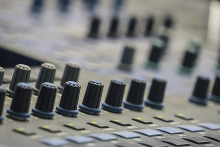 Professional sound digital mixer at a concert on stage background