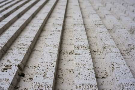 eroded: Tuff is vulcanic stone. Historical buildings in the are made from it.