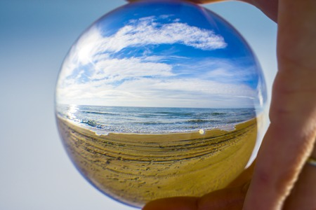 Glass ball. The fate of the planet Earth in human hands Stock Photo