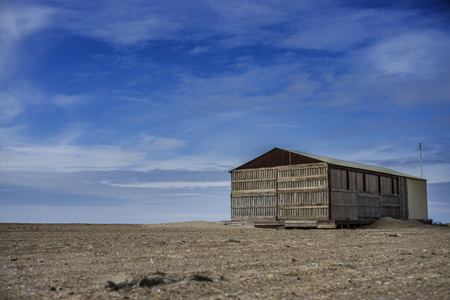 swelter: Desert landscape, lonely house at the sand.