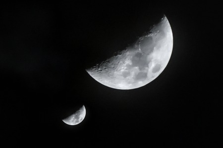 nightly: Nightly sky with two moons and clouds