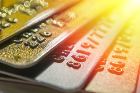 Gold and platinum credit cards close up
