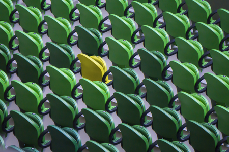 Seating rows in a stadium with weathered chairs Zdjęcie Seryjne