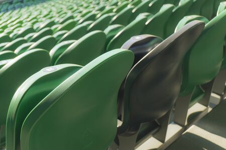 Empty plastic seats in a stadium. Matches to be played without fans