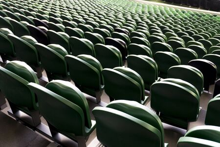 Empty plastic seats in a stadium. Matches to be played without fans 版權商用圖片 - 142123345