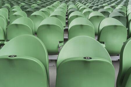 Empty plastic seats in a stadium. Matches to be played without fans.