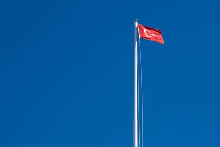 nato: The flag of Turkey against the sky. Background image. Stock Photo
