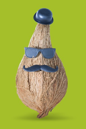 Funny coconut boss with a mustache, a hat and sunglasses. Business character photo isolated white background with clipping path