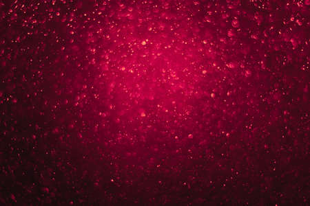 Bokeh backgrounds and bubbles reflecting the glittering red light. Like a flame Elegant and hot