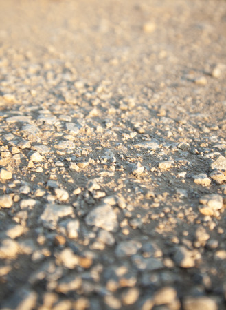 sone: Texture of sone dirt road, low angle shot. Stock Photo