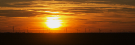 power industry: Sunset over power lines. Stock Photo