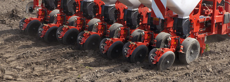 dispense: Pneumatic seeder, agricultural machinery at field