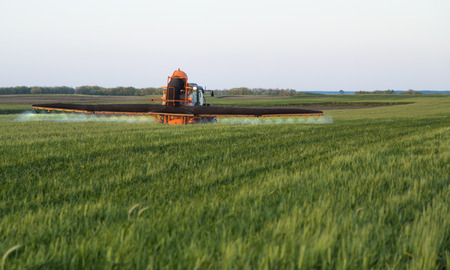 toxicity: Spraying crops field Stock Photo