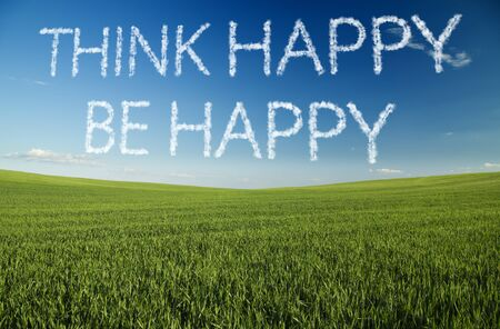 be green: Think happy, be happy written in clouds over green field Stock Photo