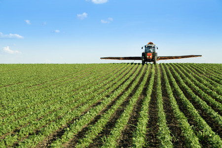 pollutant: Tractor spraying soybean crop field
