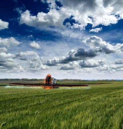 farming plant: Spraying crops field Stock Photo
