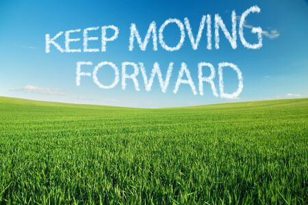 keep in: Keep moving forward written in clouds over green field