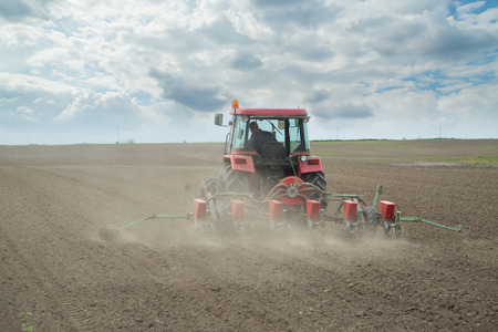 sowing: Farmer sowing crops at field Stock Photo