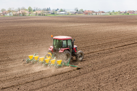 seeding: Farmer seeding crops at field