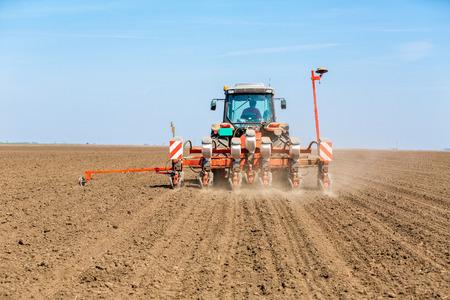 seeding: Farmer seeding soybeans