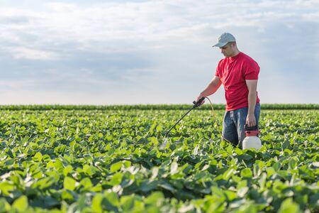 plant nature: Farmer spraying soybean plants