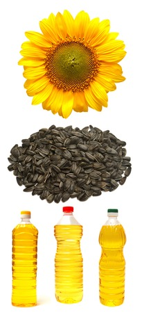 Collection sunflower, sunflower seeds and a bottle isolated on white background photo