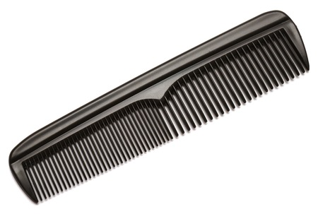 plastic comb: Black comb isolated on white background