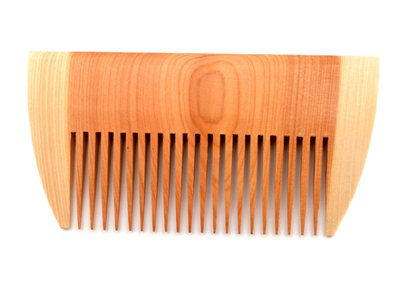 Wooden comb isolated on white background photo
