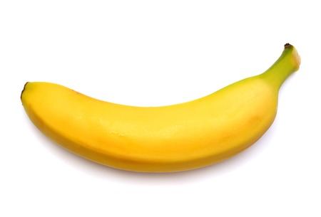 Single banana against white background Stock Photo