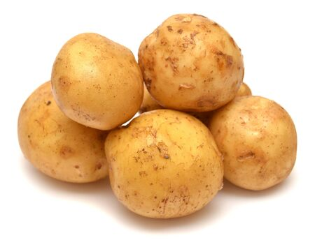 spud: Close up of potatoes on white background Stock Photo