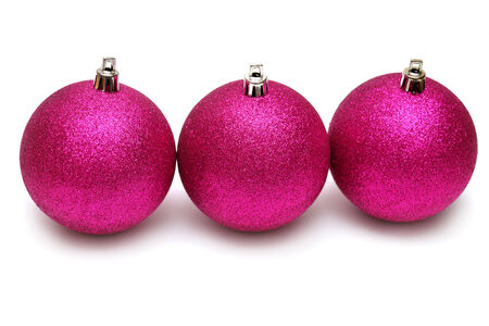 pine three: Three christmas balls isolated on a white background