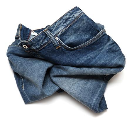白い背景で隔離しわくちゃのジーンズ 写真素材