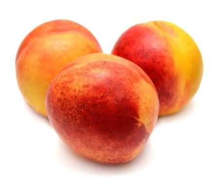 Nectarines isolated on white background photo
