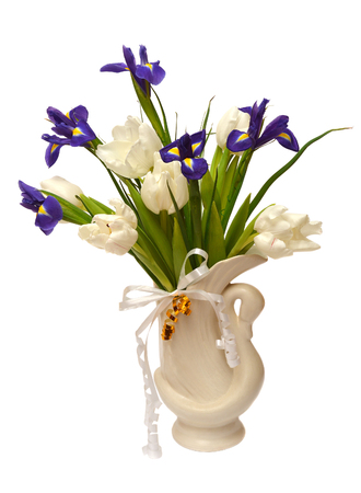 matherday: Bouquet of tulips and daffodils in a vase in the form of a swan isolated on white background Stock Photo