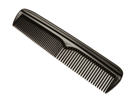 Black comb isolated on white background photo