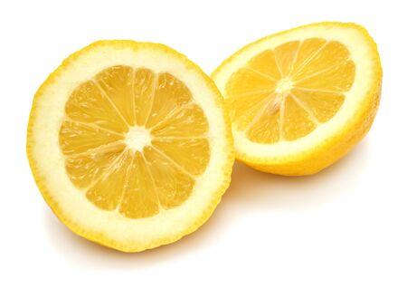 Two lemon halves isolated on white background photo