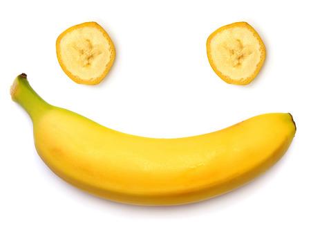 白い背景で隔離のスマイリー バナナ