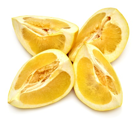 Cut into slices of fruit pomelo isolated on white background Stock Photo